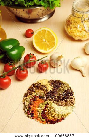 Variety of spices in the shape of a circle on the kitchen table