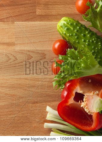 Fresh vegetables on the old wooden board. Healthy food background