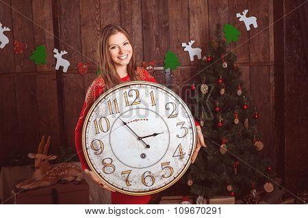 Beautiful Girl Holding Big Clock