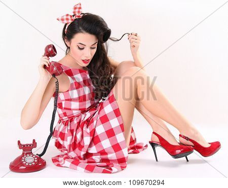 Pin up woman talking on the phone