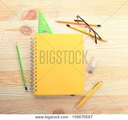 Colourful stationery on wooden background, close up