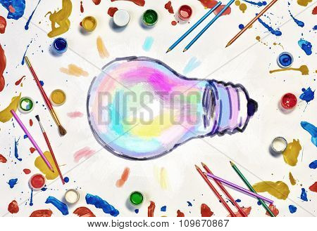 Colorful paint and brushes on white paper as symbol of creative idea