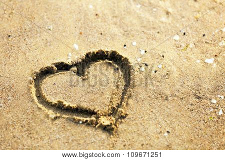 Pictured heart on the sand