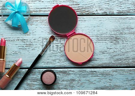 Different cosmetics on wooden background