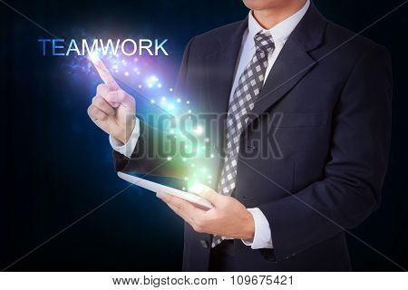 Businessman holding tablet with pressing start. internet and networking concept
