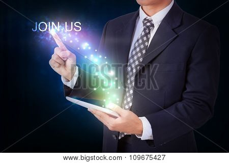 Businessman holding tablet with pressing join us. internet and networking concept