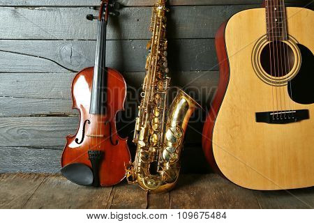 Close up view on musical instruments on wooden background