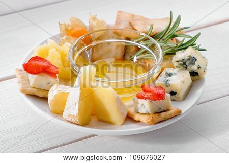 delicious cheese plate on white table