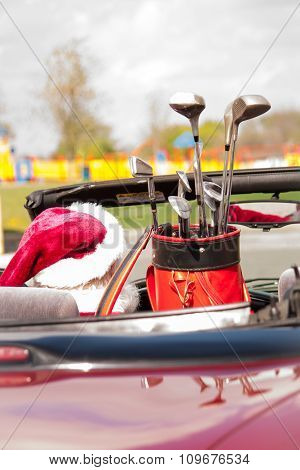 Santa In Convertible With Golf Clubs