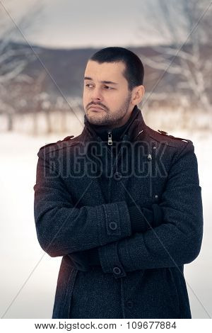 Skeptical Man Outside in Snowing Winter Decor