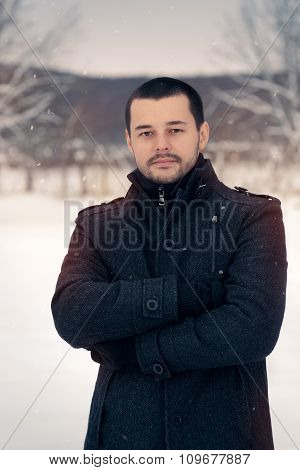 Smiling Man Outside in Snowing Winter Decor