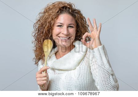 Woman With A Wooden Spon