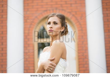 portrait of a beautiful bride in the park