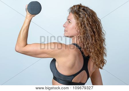 Woman Working Out With A Dumbbel