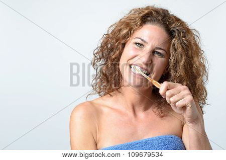Woman Cleaning Her Teeth With An Toothbrush