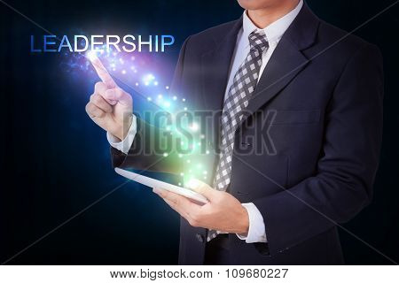 Businessman holding tablet with pressing leadership. internet and networking concept
