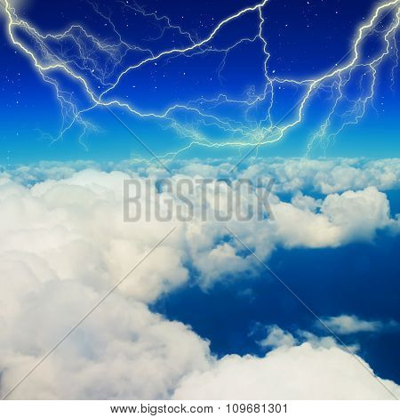 Lightning strike in blue sky with clouds.