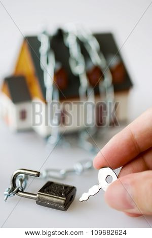 Family House And Metallic Chain As A Protection - Key Lock Security System