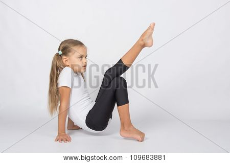 An Aspiring Gymnast Trying To Pull His Left Foot Resting On The Hands And Fingers Of The Right Foot