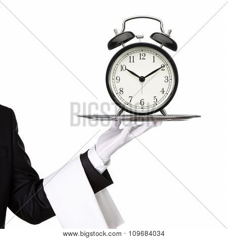 Waiter Holding Silver Tray With A Clock