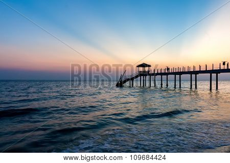 Colorful Sunset At Tropical Beach With Jetty