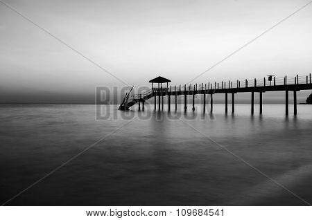Jetty At The Beach In Black And White