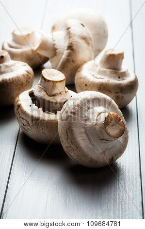 White Button Mushrooms On A Wooden Blue Table