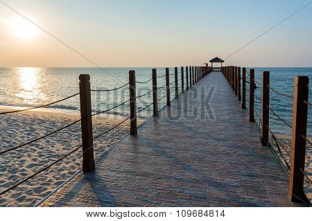 Beautiful Sunset At Tropical Beach With Jetty
