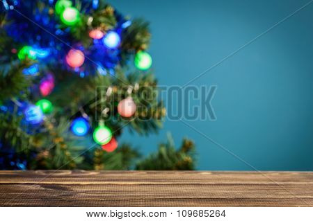 Wooden Table With Christmas Tree In The Background. Focus On The Table..wooden Table With Festive Ch