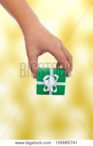 Child Hand Offering A Gift