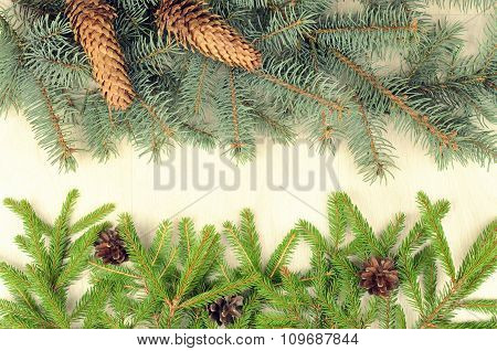 Branches Of Two Varieties Spruce And Fir Cones On A Wooden Background