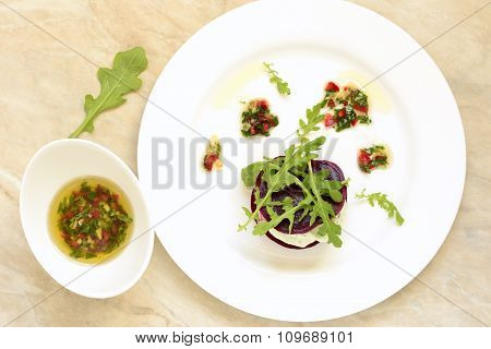 Appetizer of beet with goat cheese and sauce