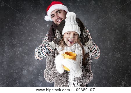 Happy Funny Couple  With A Cup Of Tea Covering  Snow Background. .have A Warm.