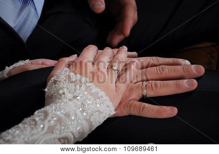 Newly Weds Holding Hands Together With The Rings On