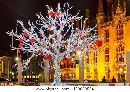 Christmas Market Place at night in Bruges, Belgium