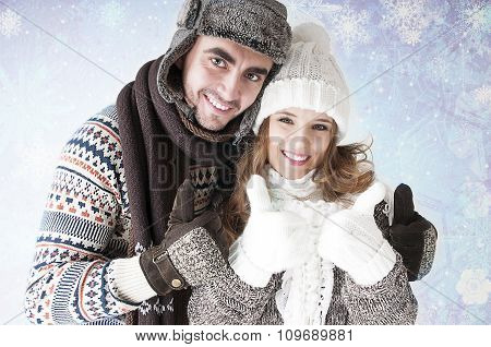 Happy Young Couple  Of Thumbs Up Gesture. Covering Snow Background.