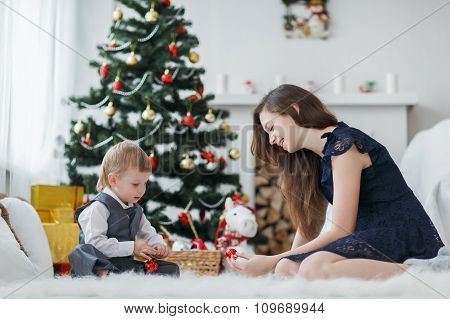 Young Family At The Christmas Tree