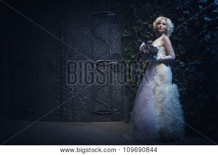 Beautiful Gothic Woman In White Dress And Roses