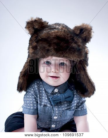 Funny Baby Boy  In A  Brown Fur Hat .