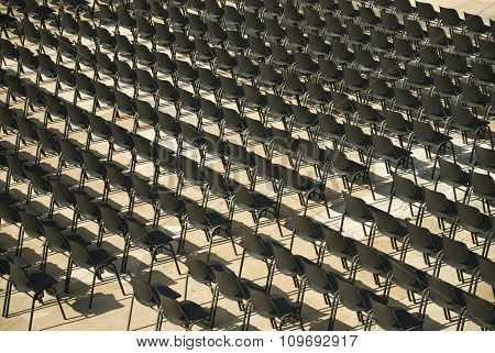 Image of numerous rows of empty seats.