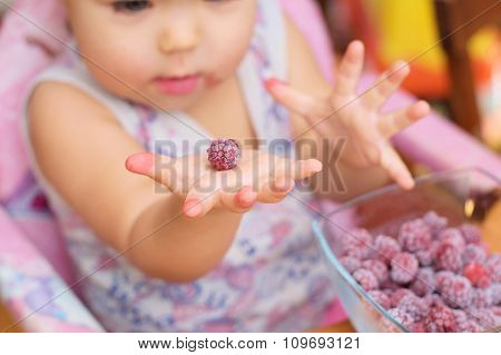 Frozen Raspberry On The Baby Hands