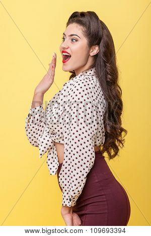 Cheerful young woman is expressing her surprise