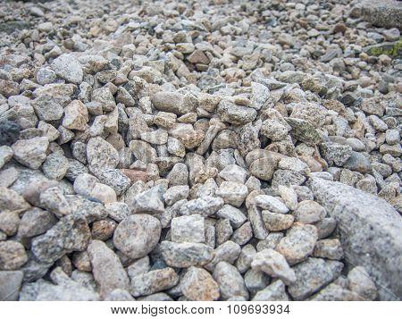 many irregular rocks on a mountain trail path