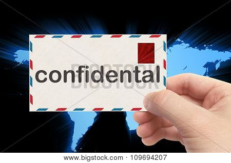Hand Holding Envelope With Confidental Word And World Background