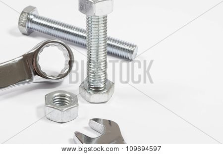 Screw, Nut, Wrench Isolated On White