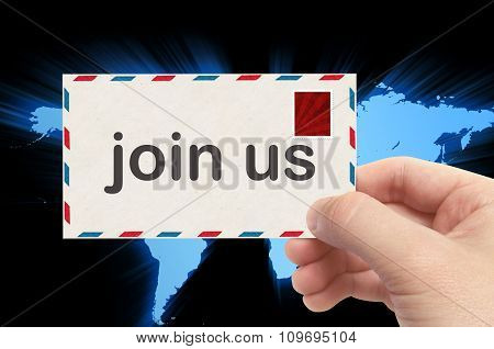 Hand Holding Envelope With Join Us Word And World Background