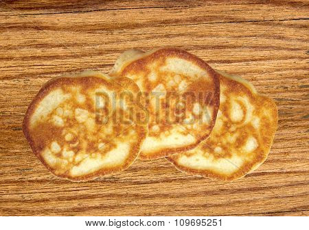 Sweet Fritters On Wooden Table Background
