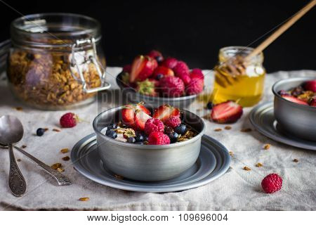 Granola With  Berries On Rustic Background