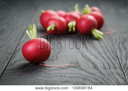 organic radishes on old oak table