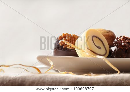 Assorted Bonbons In White Dish And Isolated Background Front View